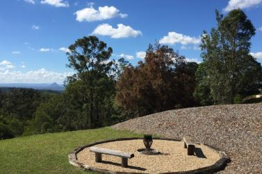 Fire pit, log benches, gravel clearing and log surrounds